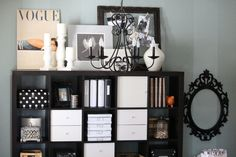like black and white and picture display on top of shelf