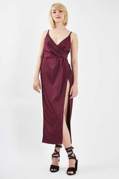 Expose a little skin in this thigh high split midi dress in a chic wrap-over style. In an evening-appropriate berry red, it comes complete with a v-neckline and open back strap detailing. Add statement shoes to compliment the look.  #Topshop