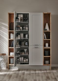 A beautiful bespoke larder storage unit in our Fairford Dove Grey kitchen.   The Shaker Collection by Howdens Joinery