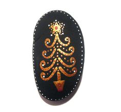 Christmas tree painted stone/paperweight by Ludibund on Etsy, $14.00