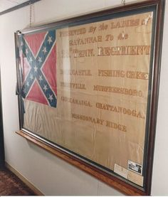 The only surviving flag of the 29th TN. This 2nd National pattern flag was given to the 29th by the ladies of Savannah, GA after the battle of Missionary Ridge. However, it was never carried in combat. Shortly after this flag was presented, Gen. Johnston ordered all units to adopt the rectangular St. Andrew's Cross pattern flag most people are familiar with today. This flag belongs to a descendant of an officer in the 29th TN, who practices medicine. The flag is on his waiting room wall.