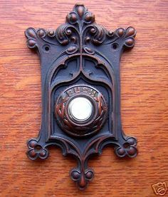 """This new resin doorbell button has a pretty Victorian swirl design with bunches of berries at the corners. With a pleasingly romantic shape, it also features a white button and the word """"PUSH"""" above it. Door Knobs And Knockers, Knobs And Handles, Door Handles, Doorbell Button, Unique Doors, Antique Hardware, Victorian Homes, Victorian Farmhouse, Modern Victorian"""