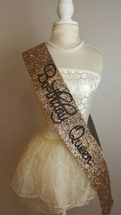 Beautiful handmade gold glitter Birthday Sash There are colour choices for this product;black, Silver, gold and pink Please ensure that you select the correct choice before ordering. Please see our shop for other options in sashes - bachelorette party, hen party etc. Please note - These are handmade made from a heavy glitter material and may vary in shape/ size. DELIVERY SCHEDULE The following postage times are in addition to manufacturing times. - UK orders are shipped via Royal Mail Fir...