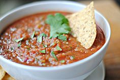 Spicy Lime Salsa    1 (14.5 oz) can no-salt-added diced tomatoes  1 (4.25 oz) can green chilies  1/2 cup chopped red onion  2 cloves garlic, chopped  Juice of 1 lime (about 3 Tbsp)  1/2 jalapeno, seeds removed and chopped  1/4 cup cilantro leaves  1/4 tsp. salt  1/4 tsp. cumin    Place all ingredients in the bowl of your food processor.  Pulse until just combined for chunky salsa or pulse more for smoother salsa.  Store in an airtight container in the fridge until ready to enjoy!