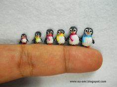 SO CUTE tiny crocheted penguins I saw on etsy. Want!