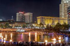 LED lighted Koi play around the basin during Waterfire