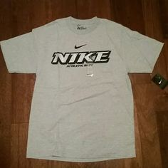 "Men's Nike T-Shirt Brand New with tags never worn, loose fit, large, silver print reading ""NIKE"" and black outlining Nike Tops Tees - Short Sleeve"