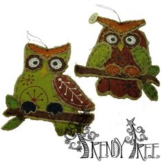 """Burlap Harvest Owl Wall Hanging Assorted Size: 13.5"""" x 11.5 Material: Burlap, Wire Two assorted styles of owl wall hangings, both have the same colors - brown, green, orange, yellow and are very similar in style. Priced individually - owl wall hanging available will be shipped."""