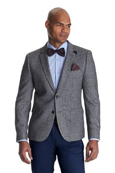 This Ventuno 21 grey herringbone slim fit jacket is single breasted with a two button fastening. The front chest pocket has print lining which can be pulled up and over for a hankie effect. This slim fit jacket has a more fashionable fit with a short body length compared to our regular or tailored fit jackets. Wear with jeans or chinos for a smart casual look.