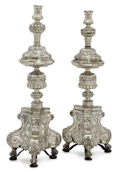 A PAIR OF SPANISH SILVER ALTAR-CANDLESTICKS |  SEVILLE, 18TH CENTURY AND LATER