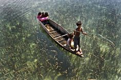 Life in Semporna, What we take for granted!! The first things I noticed: small children, no lifejackets, no adult!