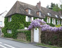 my french country home: wisteria over french gates My French Country Home, French Cottage, French Country Decorating, French Decor, Houses In France, Pergola, Brick Fence, Climbing Roses, Stone Houses