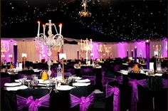 Luxe and dramatic decor with chandeliers and black. The purple can be replaced by other peacock theme colors.