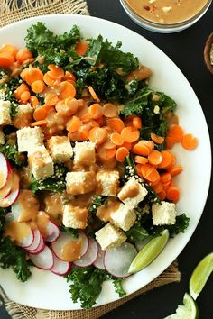Easy, Vegan Gluten Free Thai Kale Salad | Massaged Kale, Colorful Veggies, Sesame Tofu and a Simple Peanut Dressing! The perfect takelong lunch or light dinner