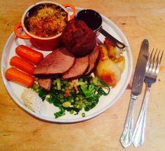 """Roast beef, dripping potatoes, Savoy cabbage with leeks, peas and smoked bacon, """"proper carrots"""", cauliflower cheese, Yorkshire puddings, horseradish and gravy."""