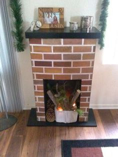 Diy faux fireplace out of cardboard i am making my own for the bedroom...it's going to be awesome.