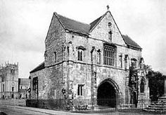 Worksop Priory gatehouse and priory church, c.1900.