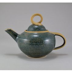 Jamie E. Hatch. Ceramic tea pot with agate and yellow glazes.
