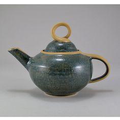 Jamie E. Hatch. Ceramic tea pot with agate and yellow glazes.