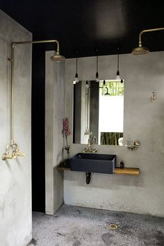 Black Ceiling Industrial Bathroom design concrete walls and floors, exposed brass shower pipes via Marika Jarv Concrete Shower, Concrete Bathroom, Concrete Walls, Concrete Sink, Brick Walls, All White Bathroom, Small Bathroom, Colorful Bathroom, White Bathrooms