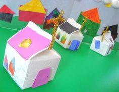 """Little milk carton (churches) houses.  I like the project.  I find the name of the site humorous: """"Catholic Icing"""".  I am not Catholic, but this is funny.  Anyway, cool little houses to make with the kiddos."""