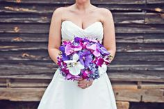 Bouquet by Chelish Moore.  Purple hydrangea base with a variety of purple and white orchids.  www.chelishmoore.com