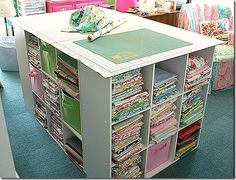 Would be good for a craft room!Bookcases in a square and crafting board on top