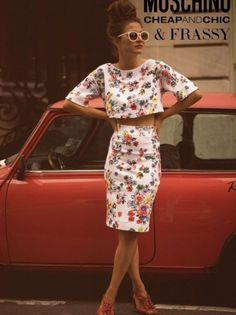 Vintage inspired white two piece summer dress with small floral print, crop top with short sleeves and knee length skirt.