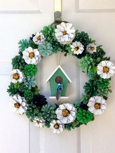 This adorable daisy pine cone wreath with birdhouse will make you smile any day of the year. Pine cones are hand painted and glued so it is not recommended for outdoor use. Put it anywhere inside to brighten up your day. This wreath measures 13.5 x 13.5.