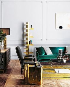 midcentury modern living room with a green velvet love seat and touches of gold
