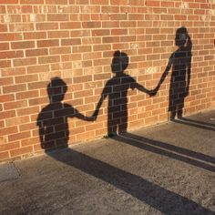 Shadows on a brick wall. Fun picture to take of the kids. Tracy, can you do this? :)