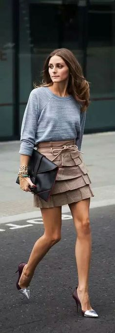 Perfect high-low pairing in neutral shades of gray and tan, with different textures. Gray sweatshirt tucked into a tan tiered mini skirt with a high waist and rope tie belt. Oversized black envelope clutch, stacked bracelets, and dope burgundy stilettos with silver metal toe caps. She did it again! Style Planet