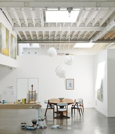 A vintage Danish dining set and Cloud pendants by Frank Gehry for Vitra anchor the room. Photo by Matthew Williams.