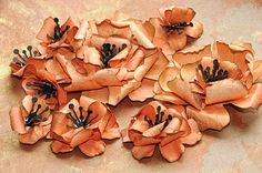 Swirly paper hibiscus flower tutorial, using Tim Holtz tattered florals Sizzix dies.