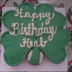 Cupcakes put together in a shape of a 4 leaf clover and covered in buttercream.