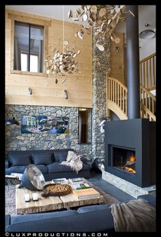 Chalet La Grange - I love the stone and light wood with dark furniture, but I really love that fireplace!
