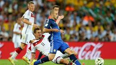 Javier Mascherano of Argentina is tackled by Miroslav Klose of Germany
