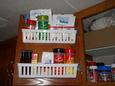 RV Organization idea:  We made an easy spice rack using inexpensive plastic bins screwed to the inside of a cupboard door.
