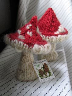 https://flic.kr/p/5pGvbT | knitted mushrooms: fly agarics | With postage stamp to show size.