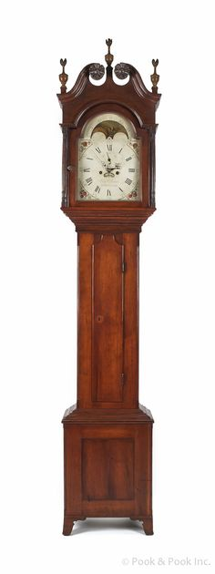 """Pennsylvania late Chippendale cherry tall case clock, ca. 1800, the broken arch bonnet enclosing an eight-day works with a painted face, inscribedBenj. Morris Bucks County, over a case with chamfered columns and bracket feet, 96"""" h."""