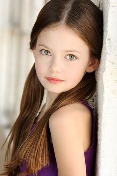 Mackenzie Foy as Daphne Collins, slightly autistic daughter of Roger Collins