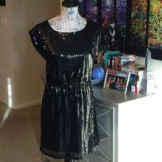 Alluring black sequin dress Alluring black sequin dress. In like new condition. Sheer upper back. Dresses