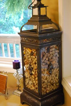 I finally found a way to display my wine cork collection ~ in a giant lantern!