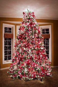 Christmas tree decorated with red & white decorations