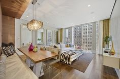 Love this living/dining room!  Bench dining. Low couch w chaise. Love the chandelier.