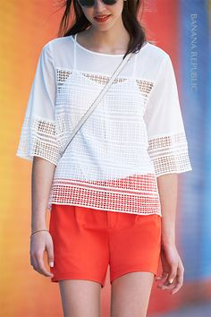 The epitome of summer in the city. Bright, colorful shorts pop with a feminine geometric lace blouse. Add heeled huarache sandals, bright lips and retro shades for cool, polished street-style.