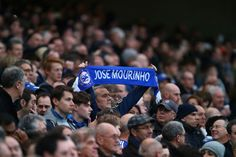 A Chelsea fan holds the Jose Mourinho scarf prior to the Barclays Premier League match between Chelsea and Sunderland at Stamford Bridge on December 19, 2015 in London, England. (Dec. 18, 2015 - Source: Clive Rose/Getty Images Europe)