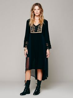 Sailing At Dusk Dress | Gauzy boho dress with scalloped crochet cuffs and a metallic design over the bust in embroidery, sequins, and fabric appliqu. Empire waist and a Hi-Lo hem. Built-in slip.