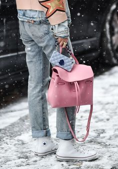 We love this pink Mansur Gavriel bag paired down with sneakers and jeans.