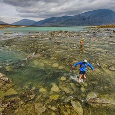 On Water . #Photo @fmarmsaterphoto  The long cold ford of the northern end of Alesjaure on day 6. Again we chose to explore the long way. After running in the rain all day on day 5 the sun made a reluctant return warming cold feet and drying wet shoes socks and souls. By this time we were in the rhythm spellbound by the environment but could sense the inevitable end of the run. One more day of bliss . Welcome to #RunnerLand  Lets follow us / Tag #RunnerLand on your photos / Turn on our post…